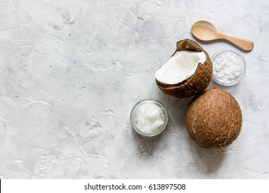 organic cosmetics concept with coconut on table background top view