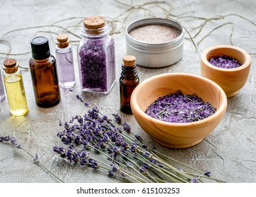 organic cosmetics with lavender on gray background