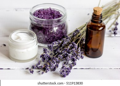 organic cosmetics with lavender on wooden background
