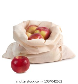 Organic cotton bag with red apples isolated on white background