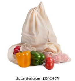 Organic cotton bags with red, yellow and green pepers and tomatoes isolated on white background