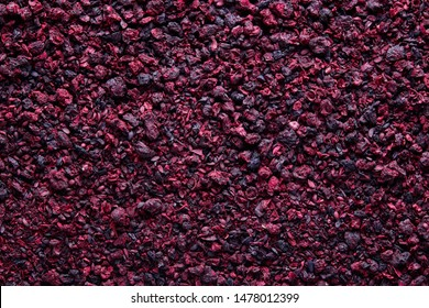 Organic dried aronia tea. Dried aronia berries are commonly used to make antioxidant-rich herbal tea.