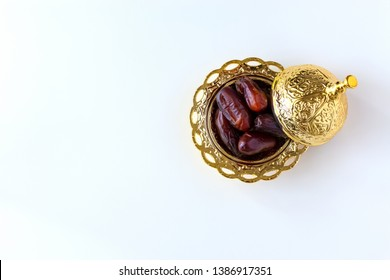 Organic dried dates in traditional arabic golden plate. Holy month Ramadan concept. Top view.
