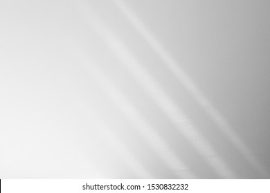 Organic drop diagonal shadow on a white wall, overlay effect for photo, mock-ups, posters, stationary, wall art, design presentation
