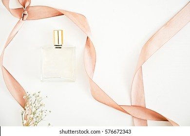 Organic dry oil for face, hair and body.  Beautiful bottle with flowers on white. Beauty blogger flat lay concept