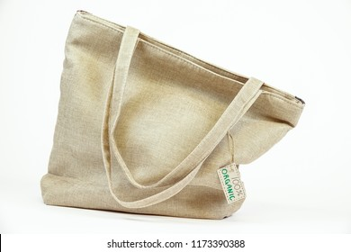 Organic eco shopping bag. Canvas tote bag. Eco textile tag. White background.