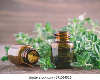 Organic essential thyme oil with green leaves of thyme Copy space.