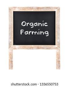 Organic farming written on chalkboard isolated