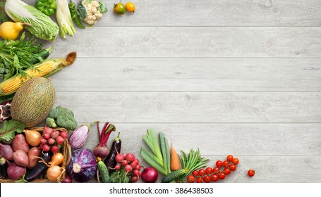 Organic food background. Studio photo of different fruits and vegetables on white wooden table. High resolution product.