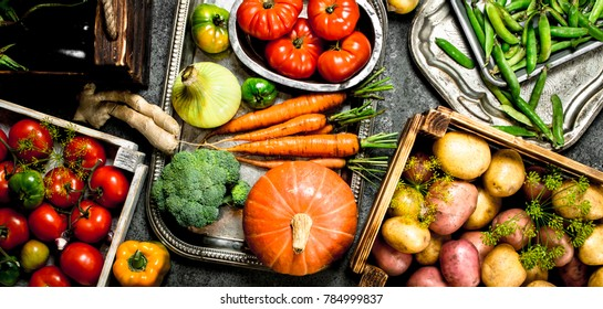 Organic food. Fresh crop of vegetables in boxes. On a rustic background.