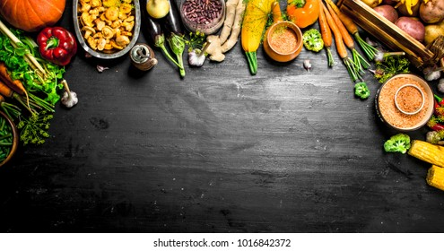 Organic food. Fresh harvest of vegetables and fruits. On the black chalkboard.