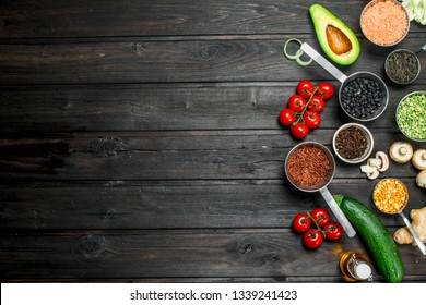 Organic food. Fresh vegetables with spices. On a wooden background.