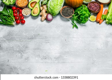 Organic food. Healthy vegetables and fruits with legumes . On a rustic background.