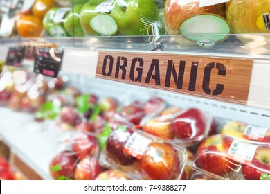 Organic food signage on modern supermarket fresh produce fruits aisle to appeal to healthy lifestyle shoppers