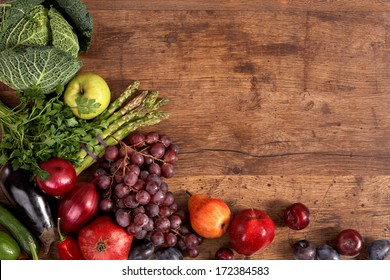 Organic foods background / studio photography of different fruits and vegetables on old wooden table