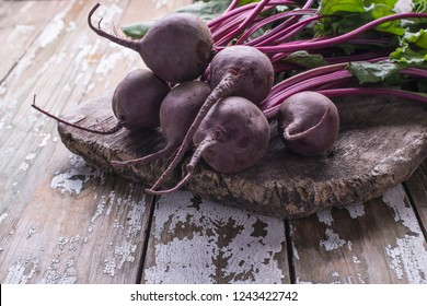 Organic fresh beetroot, frehly picked vegetables on a wooden rustic background with place for text. Vegetarian food concept.