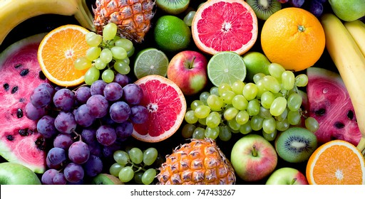 Organic fresh fruits background. Healthy eating concept. Flat lay