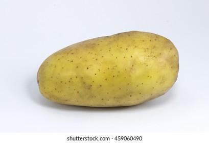 Organic fresh potatoes in net package from supermarket on white background in studio lighting.
