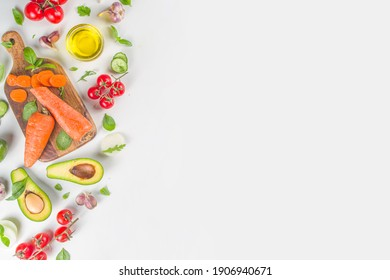 Organic fresh raw vegetables flatlay. Healthy food cooking background with various vegetable salad ingredients.  Vegetarian fresh raw food concept. Top view, copy space