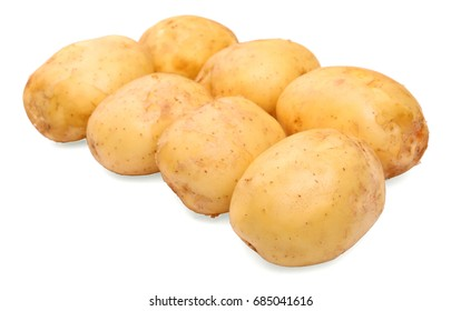 A lot of organic, fresh and raw young potatoes, isolated on a white background. Human health staple food, potatoes. Healthful summer harvest. Vitamins.