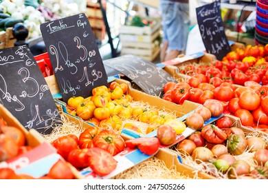 Organic fresh tomatoes from mediterranean farmers market. Healthy local food market.