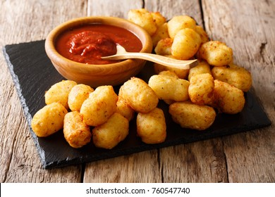 Organic Fried Tater Tots made from fried potato and ketchup close-up on the table. Horizontal