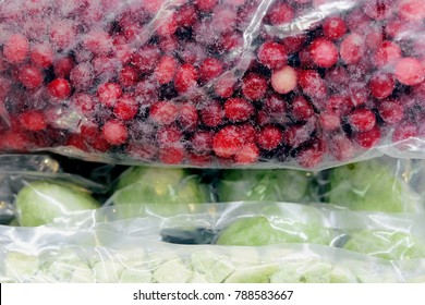 Organic frozen whole cranberries and kiwi in vacuum bag
