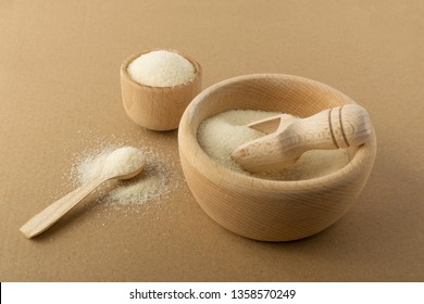 Organic gelatin powder also called hydrolyzed collagen, collagen hydrolysate, hydrolyzed gelatine and collagen peptides. Heap of dry gelatine granules used as a gelling agent