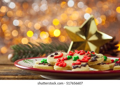 Organic Gluten Free Smiling Gingerbread Sugar Cookies On Holiday Plate And Wooden Background By Glowing Light Fireplace.