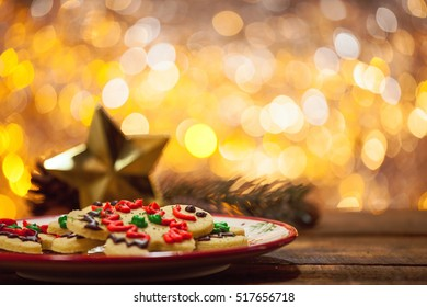 Organic Gluten Free Smiling Gingerbread Sugar Cookies On Holiday Plate And Wooden Background By Glowing Light Fireplace With Copy Space.
