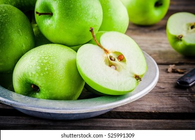 organic green juicy apples on a rustic wooden background