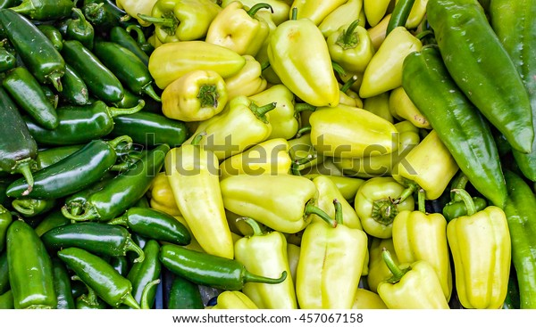 Organic green peppers at a local farmers market.