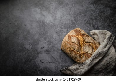 Organic homemade bread on black table