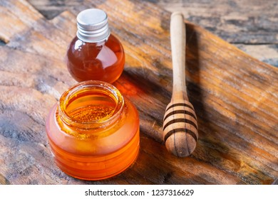 Organic honey on wooden table