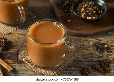 Organic Hot Chai Tea Drink with Milk and Spices