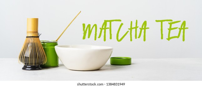 Organic Japanese green tea and tools Chasen bamboo whisk, Chashaku spoon and bowl for brewing background with text Matcha tea. Long wide banne.