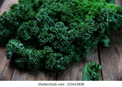 Organic kale with on old wooden background