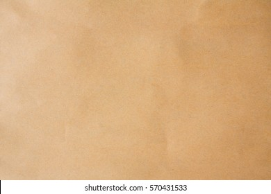 Organic kraft brown paper bag texture background on vintage table concept for luxury craft photo backdrop,  back beige smooth package, plain black tear edges parchment, blue light tone box pattern,