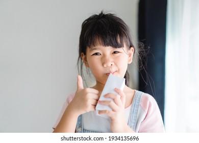 Organic lactose free milk.Asian kid girl drinking milk.Calcium vitamin from milk.Grocery, Good taste.Kid drink.School kid girl, Healthy, yoghurt, mock up product.Delicious tasty.Fruit juice.vitamin C.
