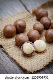 Organic Macadamia nuts on wooden.Closeup.