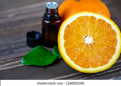 Organic mandarin orange essential oil set on wood space for natural beauty product concept