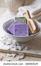 Organic Marseilles Soaps and Brush in a Ceramic Bowl