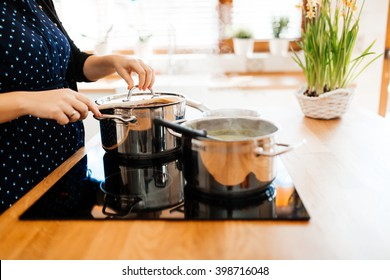 Organic meal being made in modern kitchen on induction cook top