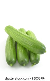 Organic mini cucumbers isolated on white background in vertical format with copy space