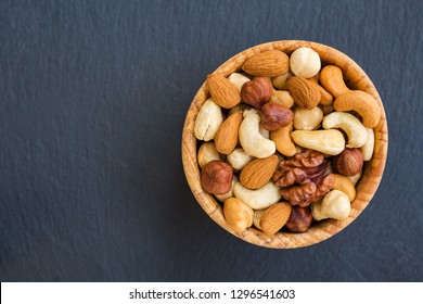 Organic mix nuts on stone background. Concept healthy snack.