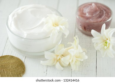 organic moisturizer creme on white wood