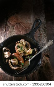Organic mushrooms pan fried in a wrought iron skillet with garlic, thyme and butter. Shot overhead with generous accommodation for copy space.