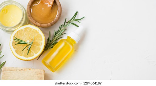 Organic natural skincare products with herbal lemon and rosemary oil, manuka honey , natural soap and salve balm, homemade treatment with organic skincare spa products, top view with copy space