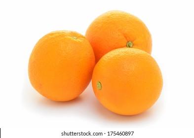 Organic navel oranges on white background