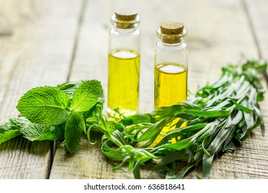 organic oil in bottle with mint on light table background